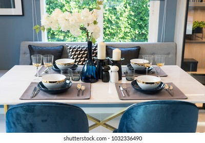 Stylish blue and white dining room with table set ready for a nice meal