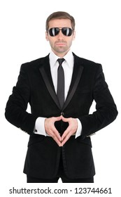 Stylish bodyguard with glasses and folded arms. Isolated over white background