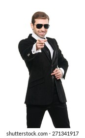 Stylish bodyguard pointing his forefinger at viewer. Isolated on a white background