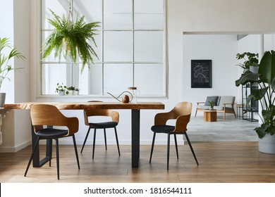 Stylish and botany interior of dining room with design craft wooden table, chairs, a lof of plants, window, poster map and elegant accessories in modern home decor. Template. - Shutterstock ID 1816544111