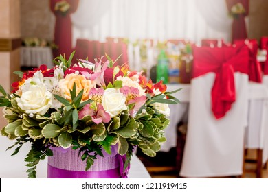 A stylish bouquet of flowers in the restaurant hall during the holiday