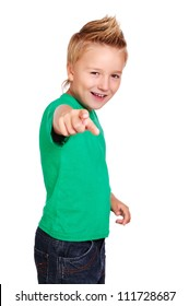 Stylish boy in green top on white background pointing with his finger