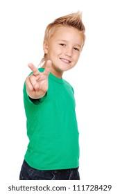 Stylish boy in green tshirt making a victory sign
