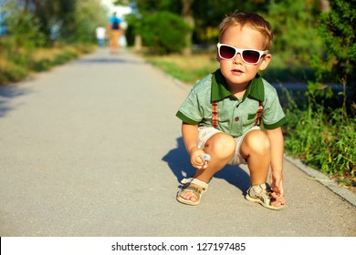 stylish boy in sunglasses, summer outdoors