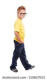 Stylish boy walking over white background  full length