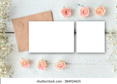 Stylish brending mockup with flowers to display your artworks. Cute vintage mock up on wooden background.