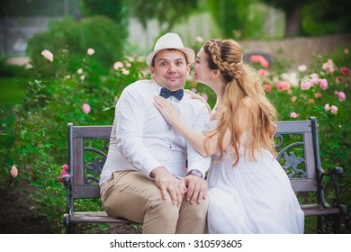 Stylish bride and groom in hat