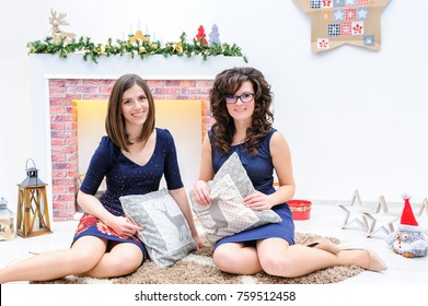 Stylish brightfull image of two joyful attractive women celebrating