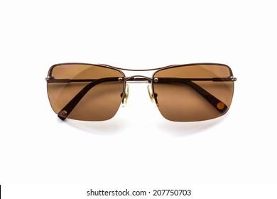 Stylish brown sunglasses on white background.