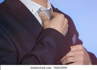 A stylish business man in a dark jacket.