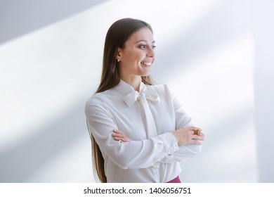 Stylish businesswoman on light background