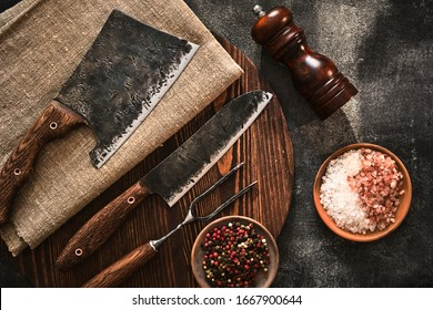 Stylish Butcher's Set: cleaver, knife and fork. Top view.