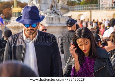 053b22d4aa Stylish celebrities in the Tuileries Garden. Paris Fashion Week  Ready to  Wear 2014-