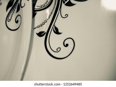 Stylish ceramic plates with black design unique photo