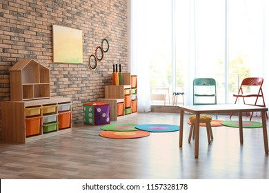 Stylish child room interior with colorful furniture