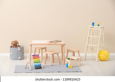 Stylish child's room interior with toys and new furniture