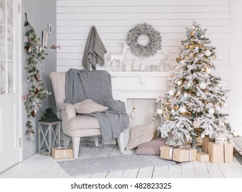 Stylish Christmas interior decorated in gray colors. Comfort home. Armchair with fabric upholstery