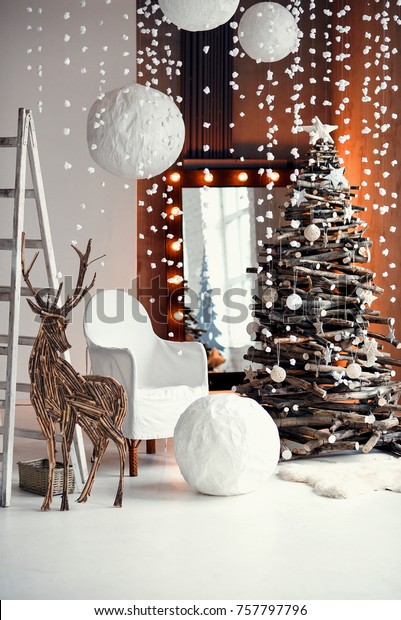 Stylish Christmas interior decorated in rustic style. Handmade festive decorations. Home family comfort.