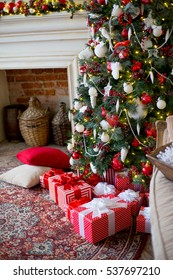 Stylish Christmas interior decorated in white and red colors. Comfort home. New Year and Christmas