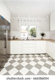 stylish clean kitchen interior  with checkered floor and sink by the window