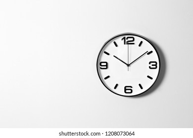 Stylish clock and space for text on white background. Time management