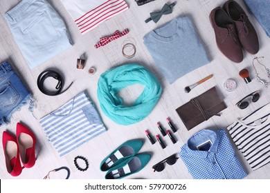 Stylish clothing set on wooden background