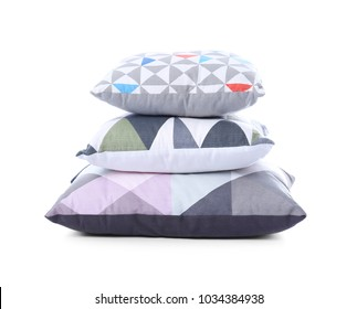 Stylish colorful pillows on white background