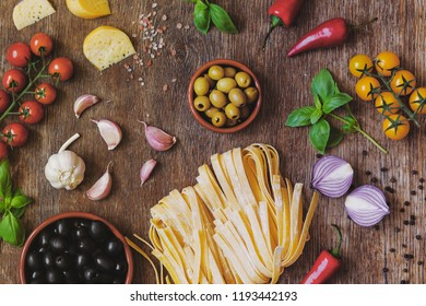 Stylish composition of fresh, italian ingredients and food on the vintage wooden table. Culinary backgrounds. Top view.