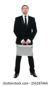 Stylish confident  businessman with metal suitcase. Full-length. Isolated over white background