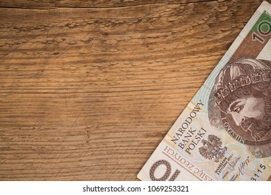 stylish copy space wint wooden background and polish zloty  bill