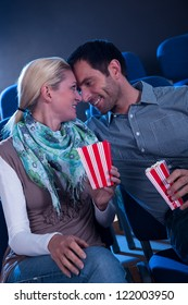 Stylish couple having romantic moment in a movie theater