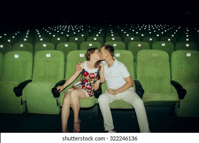 Stylish couple having romatic moment in a movie theater