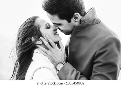 stylish couple kissing on black and white photo