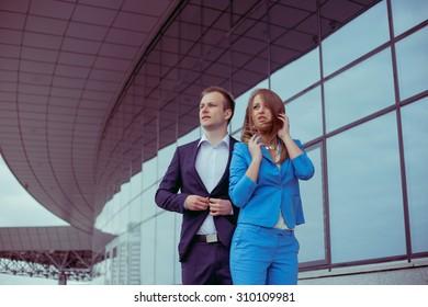 Stylish couple near business center