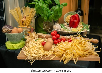 Stylish decoration of basic ingredients of Italian food - pasta, spaghetti, eggs, tomatoes and garlic