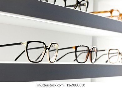 Stylish design glasses on shelves in a shop