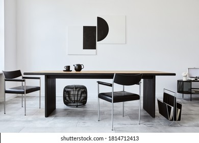 Stylish dining room interior with design wooden family table, black chairs, teapot with mug, mock up art paintings on the wall and elegant accessories in modern home decor. Template. - Shutterstock ID 1814712413