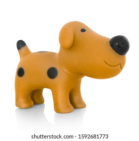 Stylish dog plastic toy. Isolated on white background with shadow reflection. With clipping path. Brown doggy with black stains.