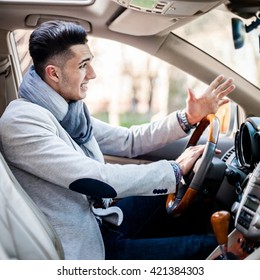 Stylish driver inside his own luxury car anger