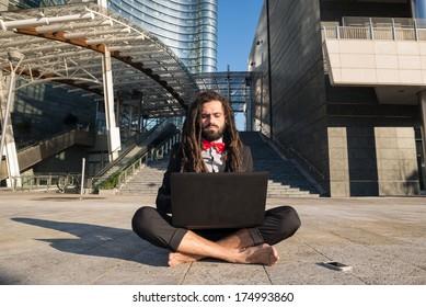 Stylish elegant dreadlocks businessman in business landscape