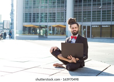 Stylish elegant dreadlocks businessman using notebook in business landscape