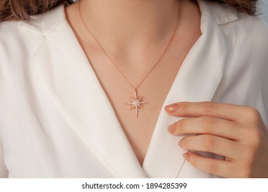 Stylish elegant necklace on the neck of the girl dressed in white