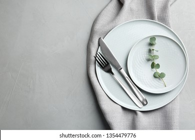 Stylish elegant table setting on light background, top view. Space for text