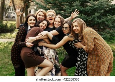 stylish elegant women having fun at celebration in sunny park, funny moment concept, gathering together, photo booth