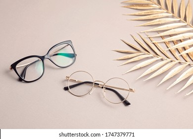 Stylish eyeglasses over pastel  background. Optical store, glasses selection, eye test, vision examination at optician, fashion accessories concept. Top view, flat lay