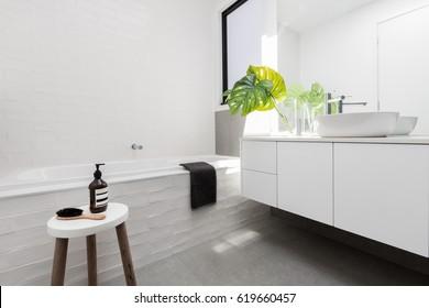 Stylish family bathroom of white scandinavian theme