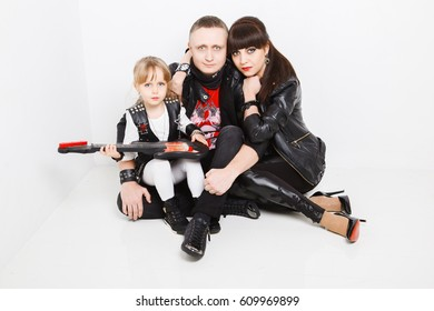 Stylish family in leather clothing