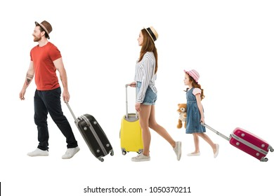 Stylish family of tourists carrying suitcases isolated on white, travel concept