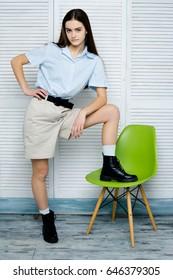 Stylish fashion model in shirt and shorts posing