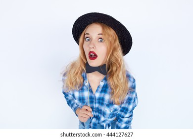 afc86f20115 Stylish fashion portrait of trendy casual young woman in blue shirt and  black hat holding a